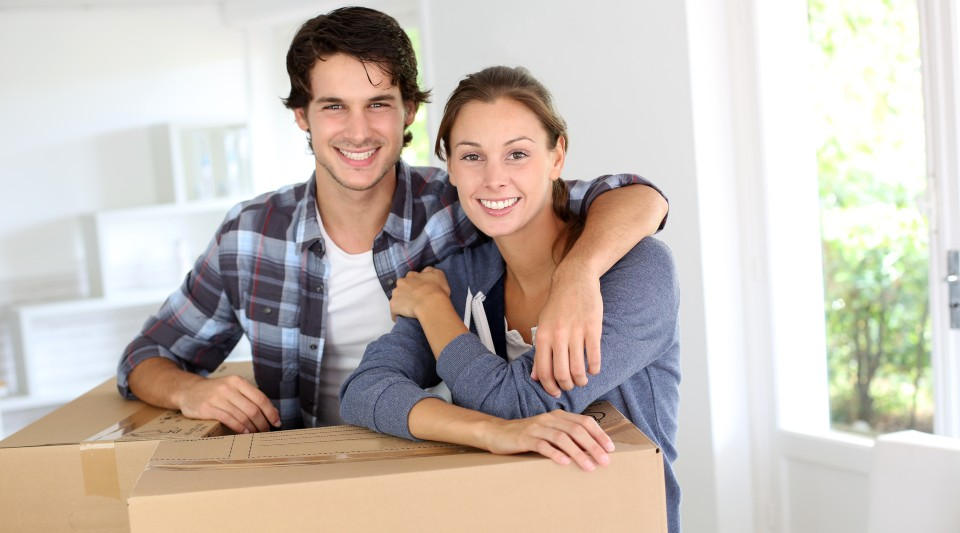 Young couple during move to new home